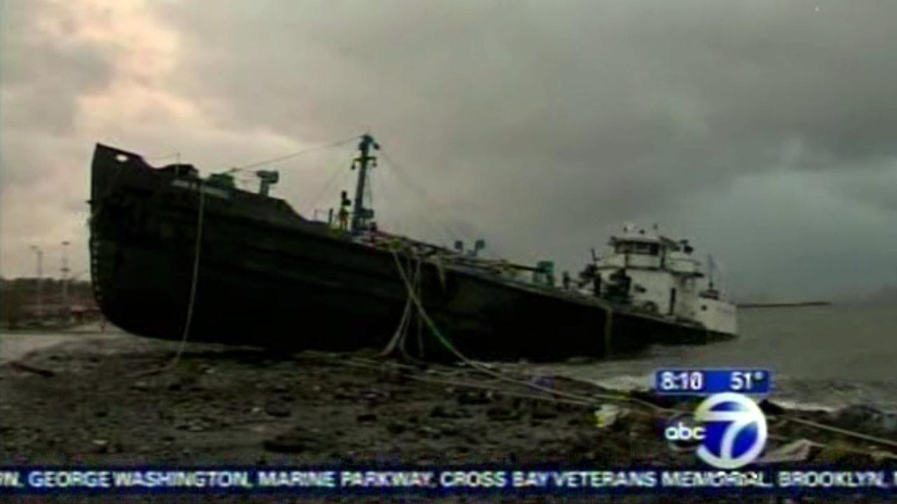 A 700-ton tanker ran aground on Front Street in the New York City borough of Staten Island.  The 168-foot John B. Caddell is a water tanker that was moored about a mile off the beach.