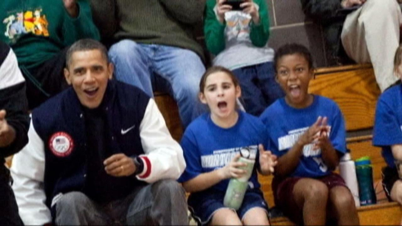 President Obama sits on the bench as he coaches Sashas basketball team.