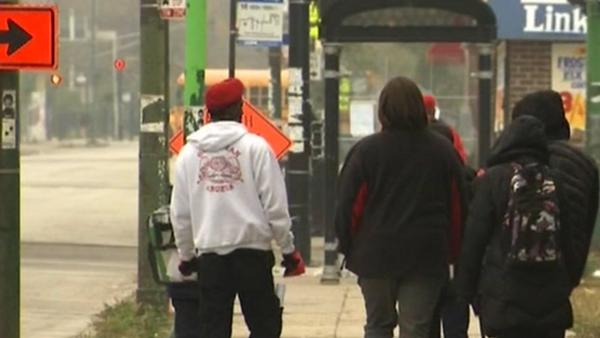 Guardian Angels walk West Side kids to school after attack
