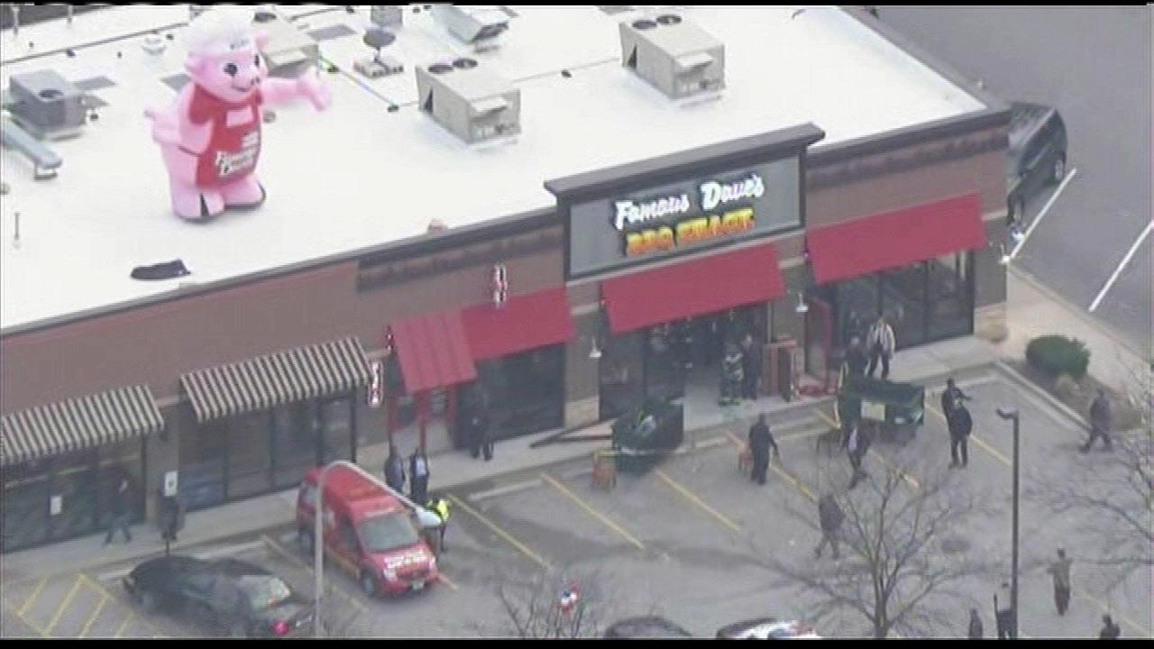 A car crashed into a Famous Daves restaurant in Evergreen Park on Monday afternoon, Nov. 19, 2012.