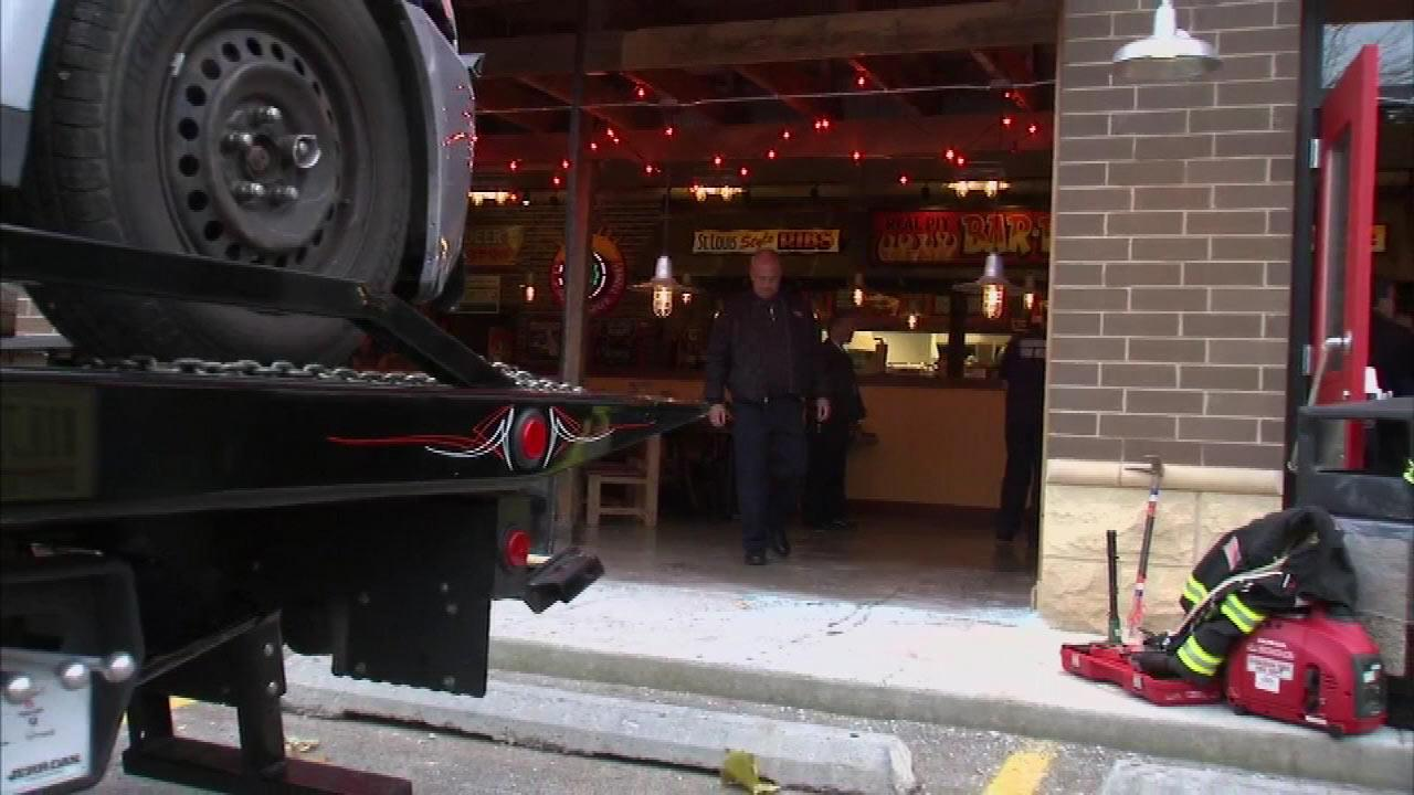 Officials say about 100 people were inside the new Evergreen Park Famous Daves when a car slammed into the front window of the restaurant, located in the 2800-block of West 95th Street in the south suburb, on Monday afternoon, Nov. 19, 2012.