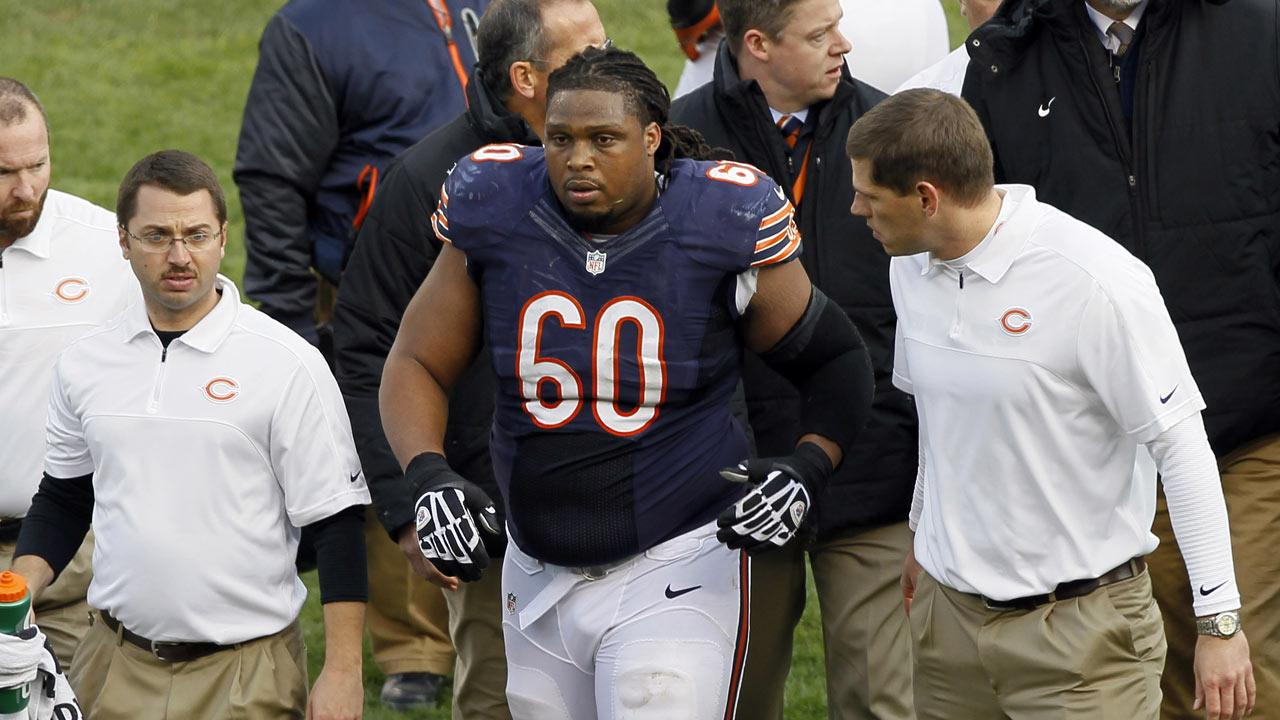 Chicago Bears guard Lance Louis (60) is helped from the field by trainers after an injury in the second half of an NFL football game against the Minnesota Vikings in Chicago, Sunday, Nov. 25, 2012. (AP Photo/Charles Rex Arbogast)
