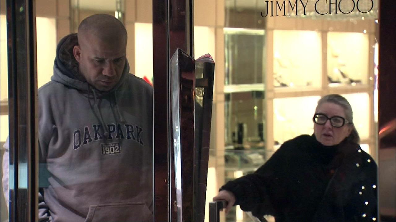 Police say three men busted into the Jimmy Choo designer shoe store on Oak Street and stole designer shoes and handbags, Thursday, Dec. 6, 2012.