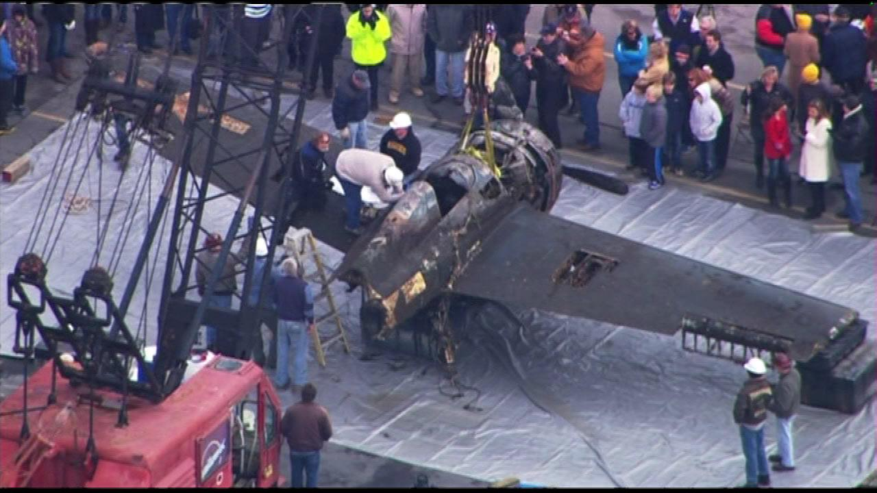 Crews recovered a World War II-era plane from the bottom of Lake Michigan, Friday, Dec. 7, 2012.