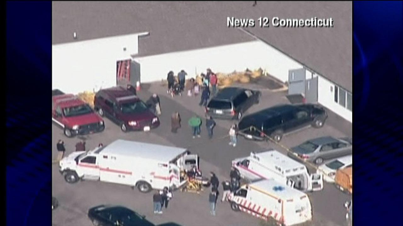 Images show the scene of a shooting at Sandy Hook Elementary School in Newtown, Conn., December 14, 2012.