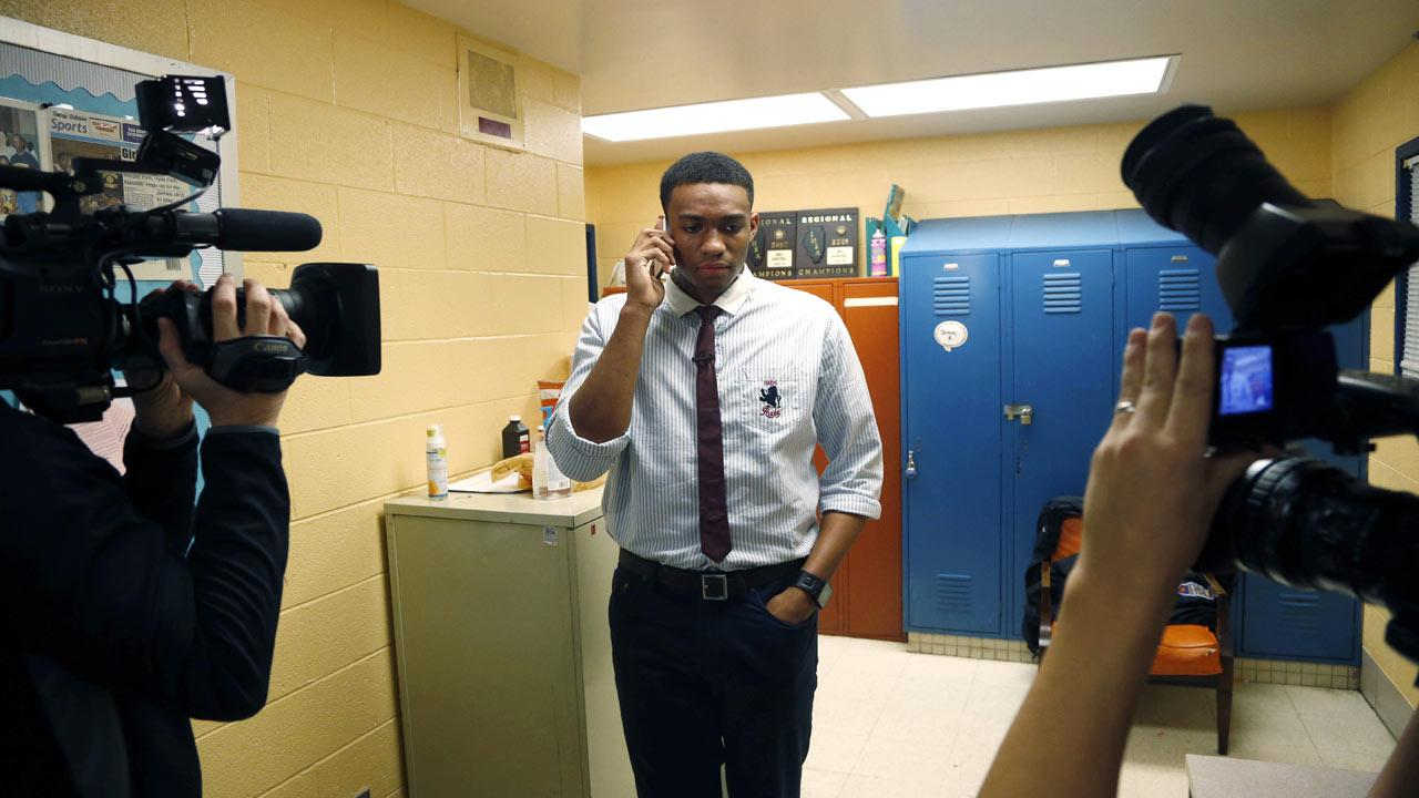 Simeon Career Academys Jabari Parker talks on the phone with Duke head coach Mike Krzyzewski after announcing he will be attending Duke to play NCAA college basketball during a news conference at his high school, Thursday, Dec. 20, 2012, in Chicago. (AP Photo/Charles Rex Arbogast)