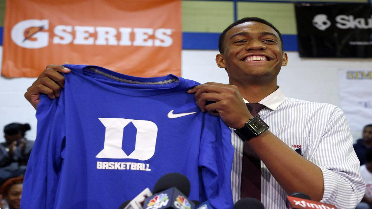 Chicagos Simeon Career Academys Jabari Parker announces he will be attending Duke during a news conference at his high school Thursday, Dec. 20, 2012, in Chicago. (AP Photo/Charles Rex Arbogast)