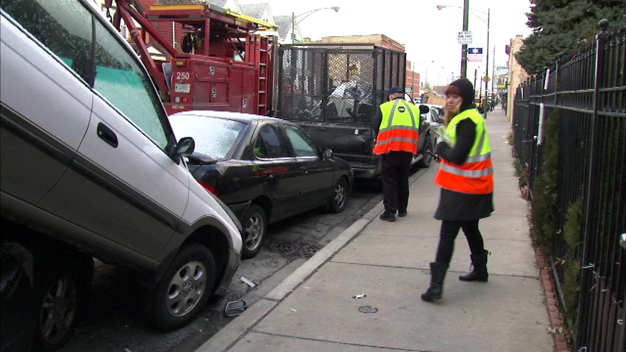 A CTA bus crashed into about 20 parked cars after the driver lost consciousness, Friday, Dec. 21, 2012.