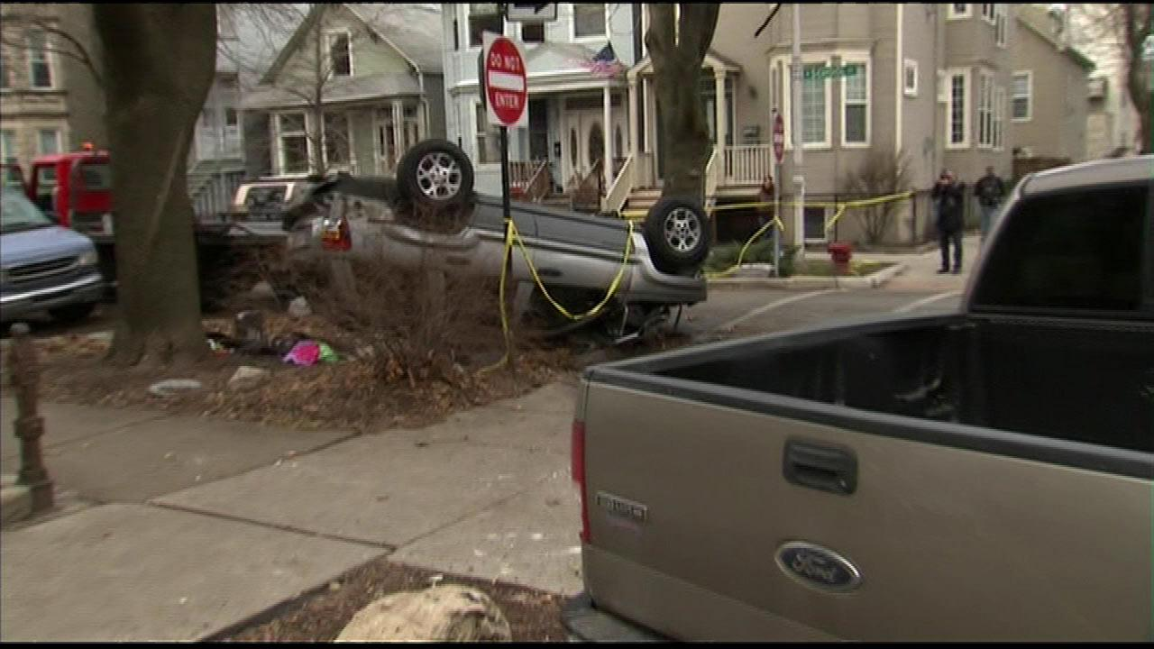Police say a driver was fleeing the scene of a crime when the car flipped near the intersection of Paulina and School on Chicagos North Side, Thursday, Jan. 10, 2013.