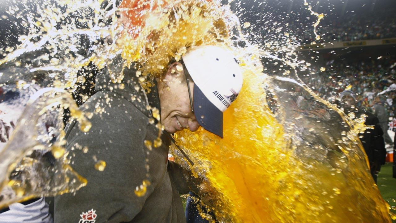 Montreal Alouettes head coach Marc Trestman is doused with Gatorade after their Grey Cup win over the Saskatchewan Roughriders,  Sunday November 28, 2010, in Edmonton.  The Chicago Bears hired Trestman as the teams new head coach.  (THE CANADIAN PRESS/Nathan Denette)