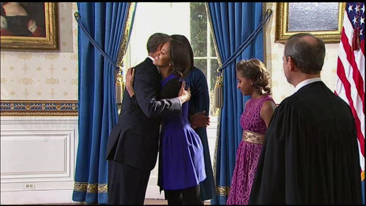 President Obama hugs his eldest daughter Malia Obama.
