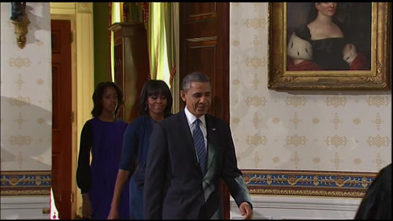 President Obama, the First Lady and Malia Obama enter the Blue Room for the ceremony.