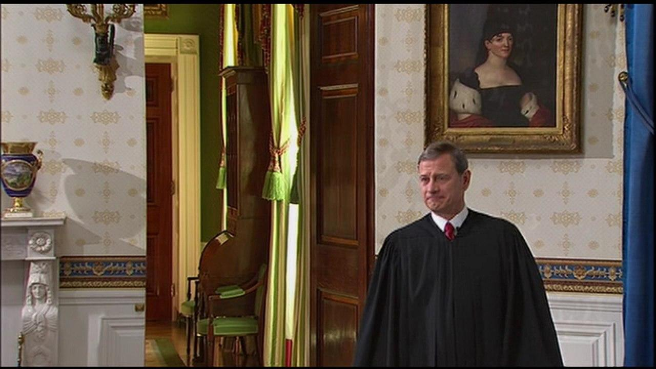 Chief Justice John Roberts enters the Blue Room for the ceremony.
