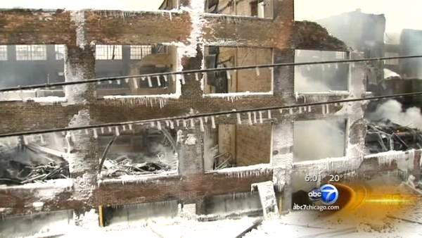 Warehouse fire being monitored for hot spots