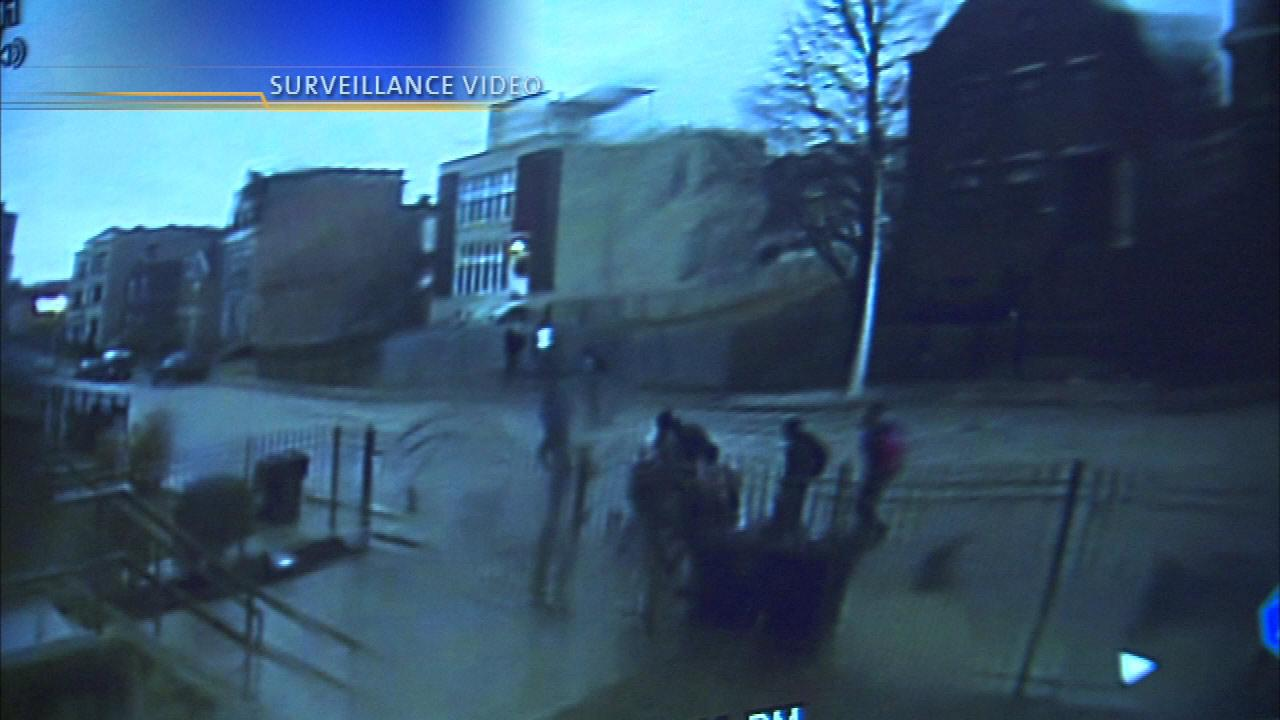 A surveillance camera captured video of several young people fleeing the scene.
