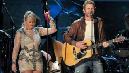 Recording artists Miranda Lambert, left, and Dierks Bentley perform at the 55th annual Grammy Awards in Los Angeles.