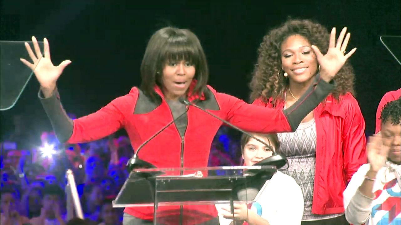 Serena Williams on stage with first lady Michelle Obama at the Lets Move event at McCormick Place in Chicago, Thursday, February 28, 2013.