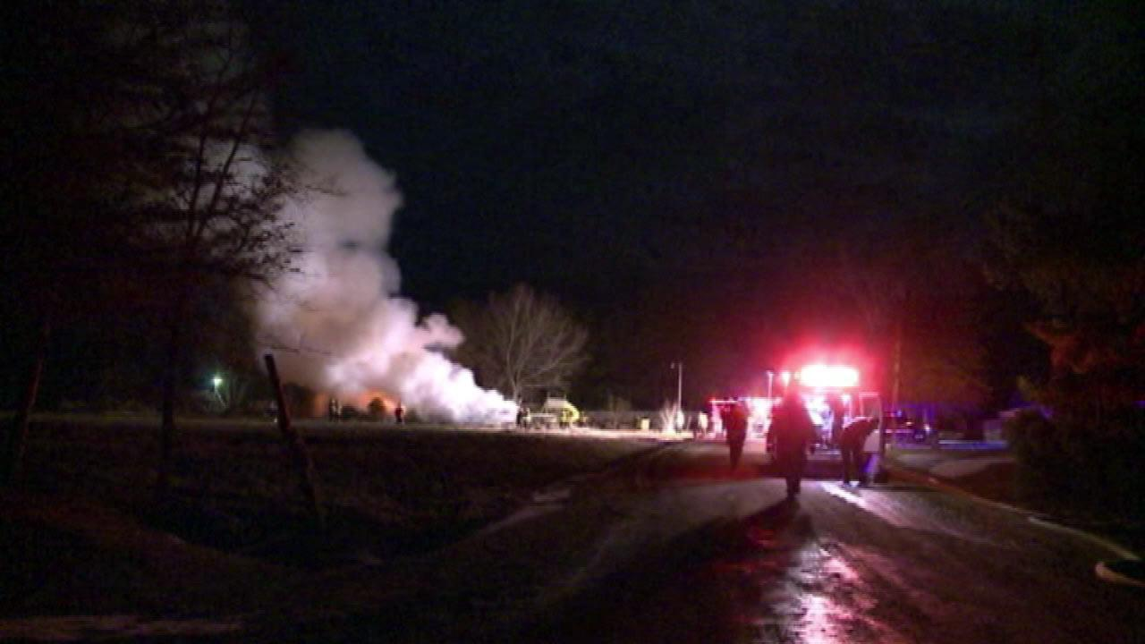 Images from scene of fatal mobile home fire south of the Quad Cities Wednesday morning, March 27, 2013, in Sherrard, Illinois.