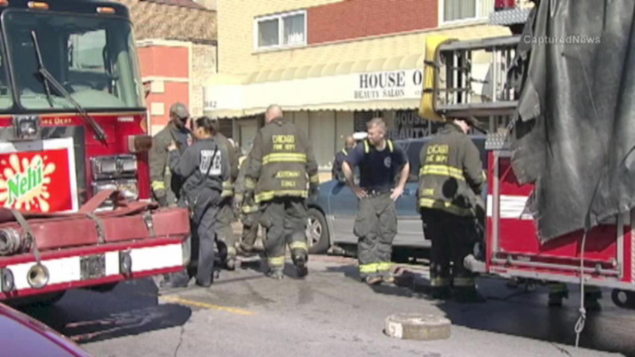 A woman and child pulled from a burning building near Jeffery and 79th Street in the South Shore neighborhood both died, Wednesday, April 3, 2013.
