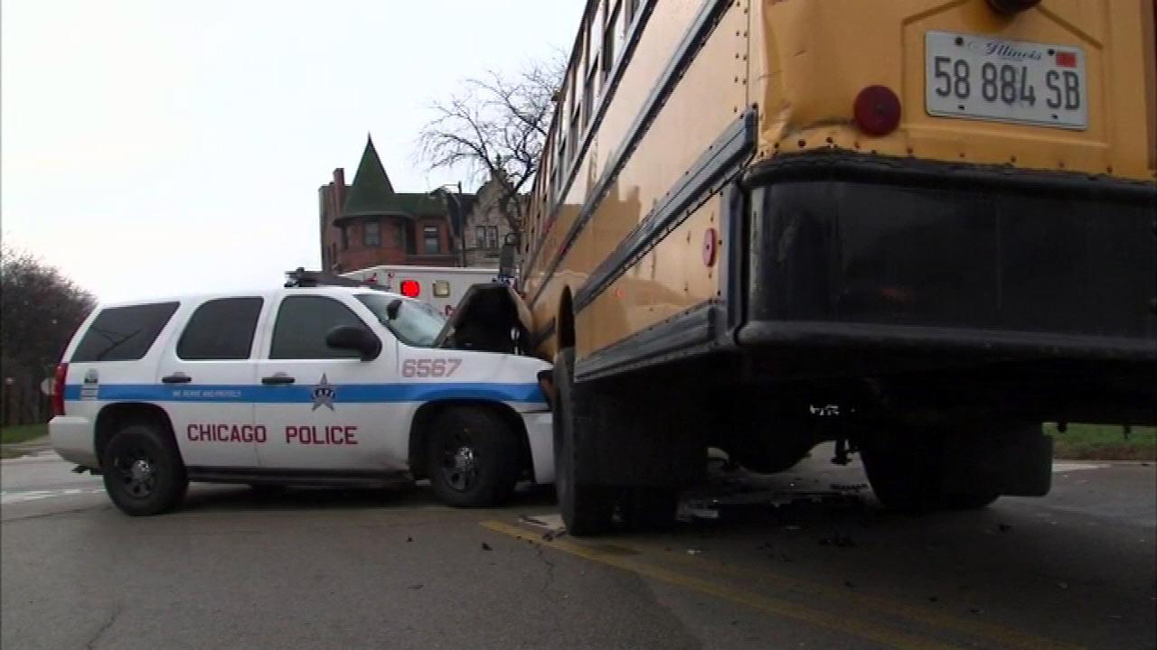 Two people were rushed to the hospital after a police squad collided with a school bus on Chicagos South Side  at 42nd and King Drive, Tuesday, April 9, 2013.