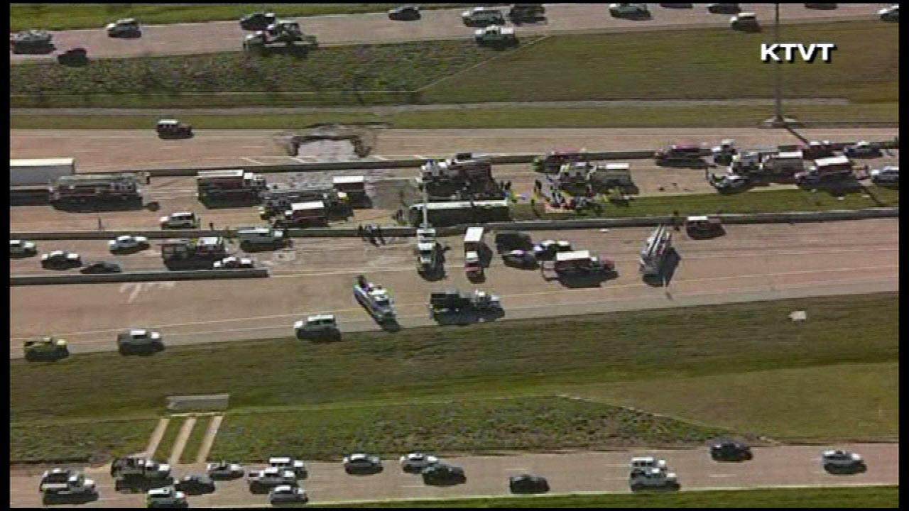 A charter bus overturned Thursday, April 11, 2013, just east of Dallas-Fort Worth International Airport in Irving, Texas.