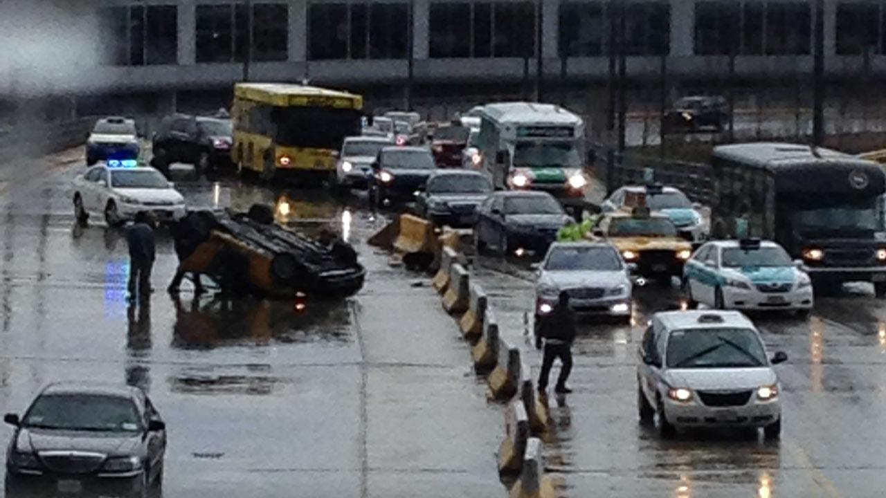 A taxi overturned Wednesday morning, April 17, 2013, at OHare Airport.