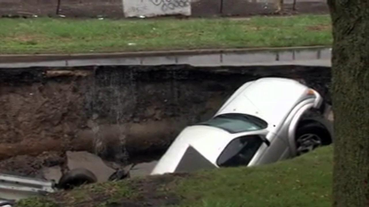 A sinkhole swallowed three cars at 96th and Houston in the Jeffery Manor neighborhood. It started to open around 5:15 a.m., Thursday, April 18, 2013.