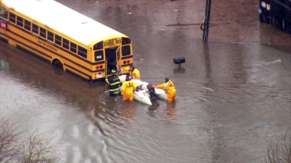 Students had to be rescued after a school bus stalled at 158th between East End and Greenwood streets in Dolton, Thursday, April 18, 2013.