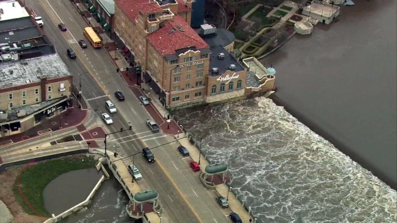 The banks of the Fox River swell near the Hotel Baker in downtown St. Charles, Ill. (Chopper7 image)