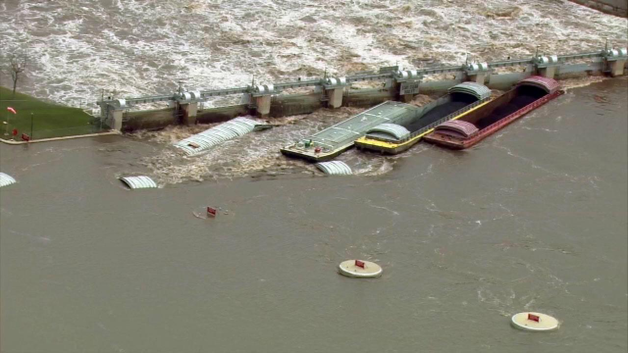 Nine barges along the Illinois River busted into the dam at Marseilles, Illinois, sending massive amounts of water flowing into town.  (Chopper 7 image)