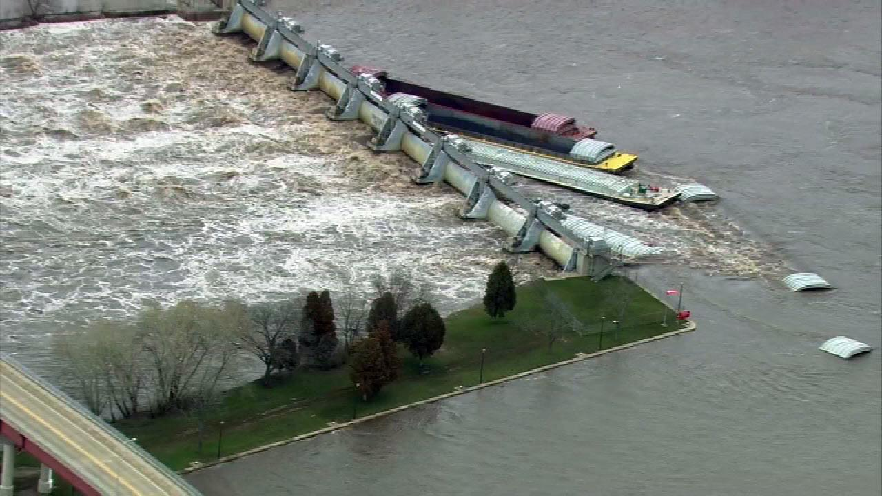 Nine barges along the Illinois River busted into the dam at Marseilles, Illinois, sending massive amounts of water flowing into town.