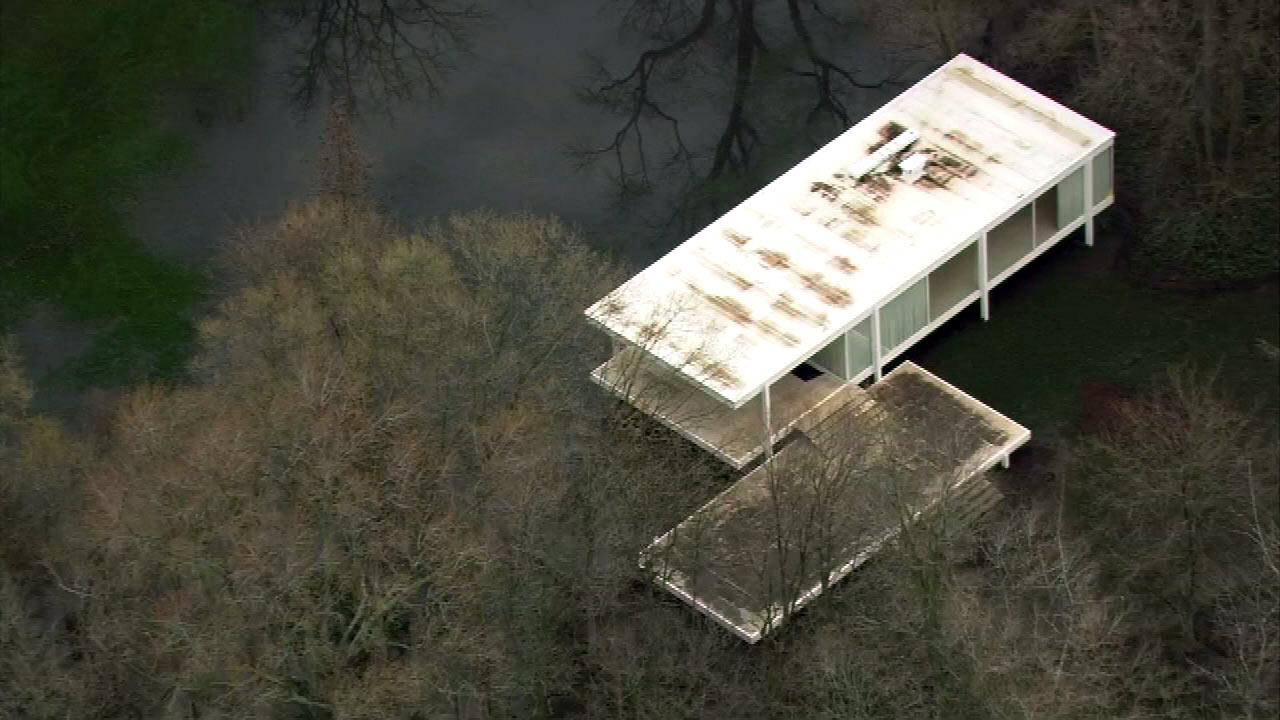 High water from the swollen Fox River threatens the Mies van der Rohe-designed Farnsworth House in Plano.(Chopper7 image)
