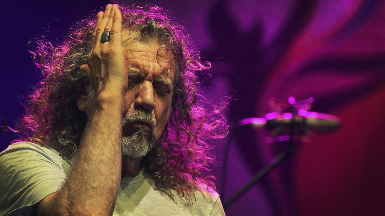 Robert Plant, lead vocalist and lyricist of the rock band Led Zeppelin, performs during the Timbre Rock and Roots concert in Singapore.  (AP Photo/Wong Maye-E)