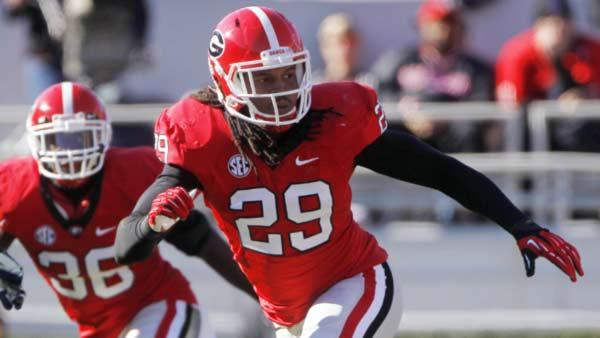 In this file photo, Georgia linebacker Jarvis Jones (29) follows the action during an NCAA college football game against Georgia Southern in Athens, Ga. The All-American linebacker