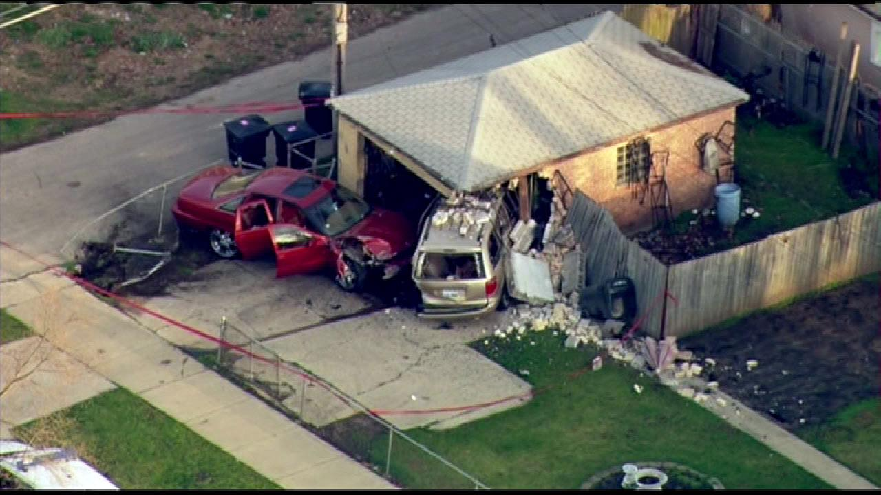 A car crashed into a garage in the 11500-block of South Lowe, striking a van that was parked in front of the garage, Friday morning, April 26, 2013, police said.