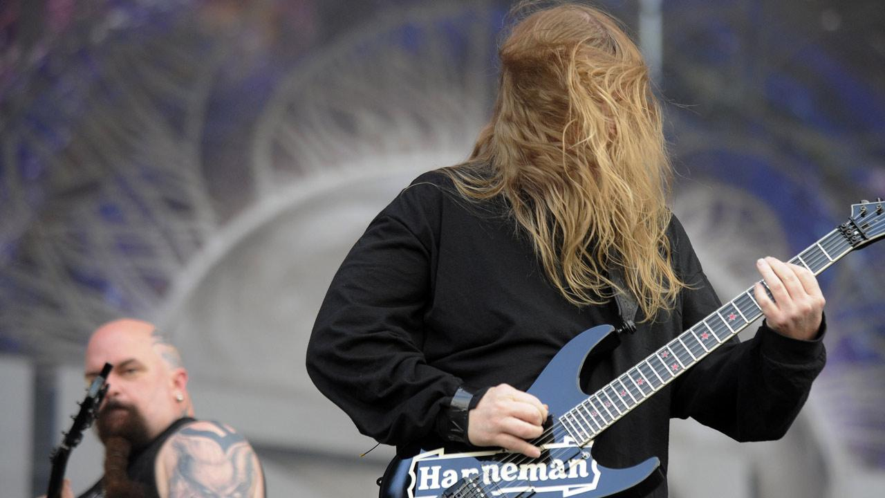 Jeff Hanneman (right) of the American trash metal band Slayer performs during the Sonisphere festival concert in Warsaw, Poland, in this file photo. (AP Photo/Alik Keplicz)