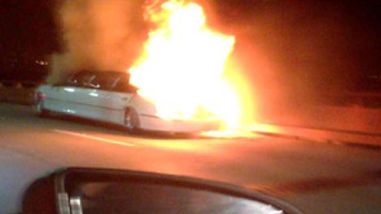This frame grab taken from video provided by Roxana and Carlos Guzman shows a Limo on fire on the San Mateo-Hayward Bridge in San Francisco.   (AP Photo/Roxana and Carlos Guzman)