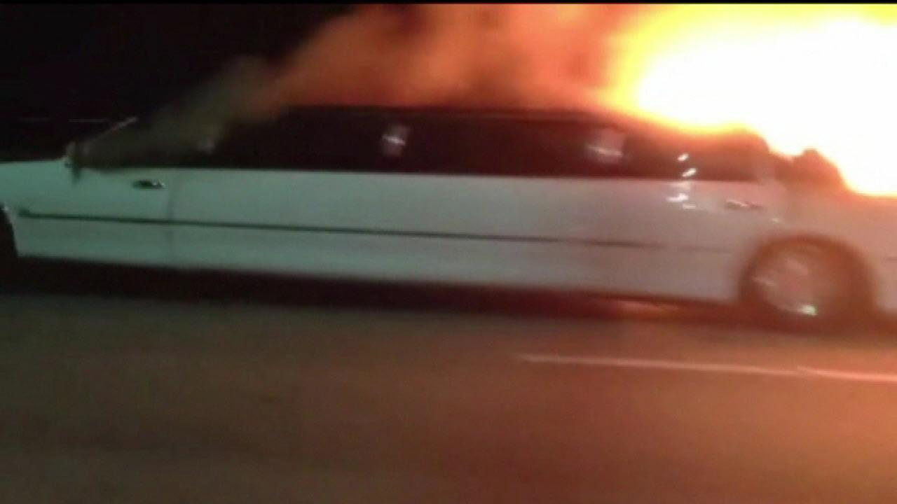 Fire roared through a limousine packed with women on the San Mateo-Hayward Bridge over San Francisco Bay.