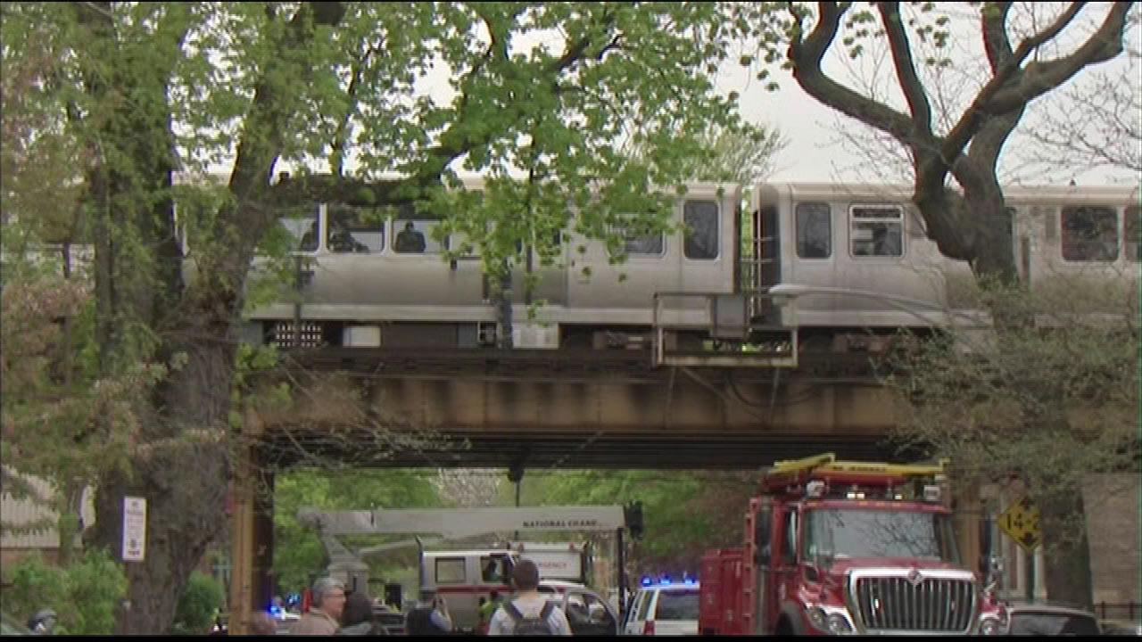 Passengers wait to disembark after a CTA Red Line train derailed in the Lincoln Park neighborhood, Thursday, May 9, 2013.