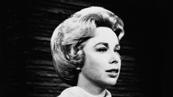 Psychologist Dr.Joyce Brothers shown in the studio of her direct line radio show, saved a would-be suicide.