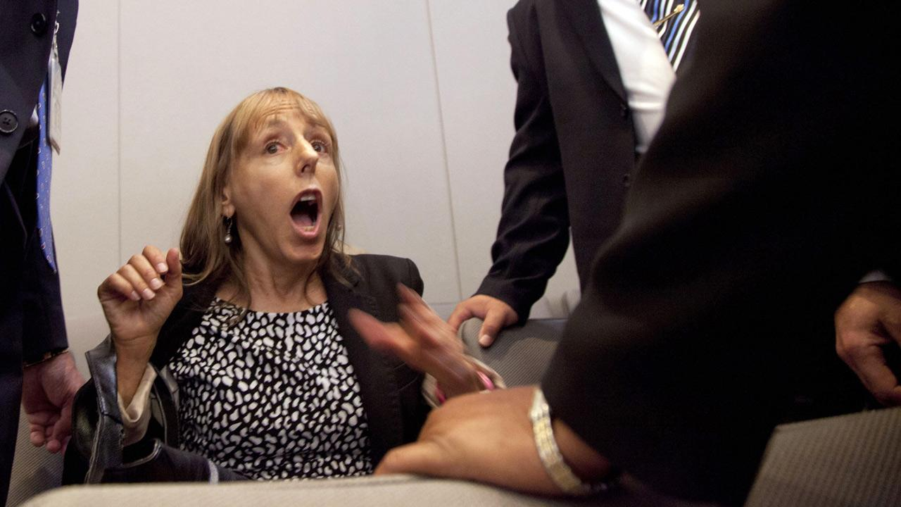 Code Pink founder Medea Benjamin is surrounded by security as she shouts at President Barack Obama during his speech on national security.  (AP Photo/Carolyn Kaster)