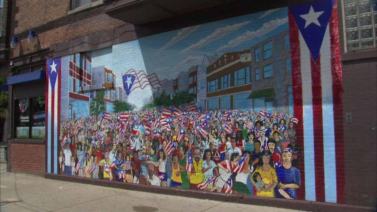 Mural art adding character to humboldt park for Character mural