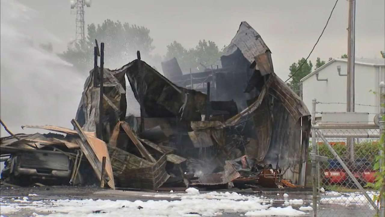 Fire and then explosions destroyed a trucking company in northwest Indiana, which thick black smoke seen for miles.