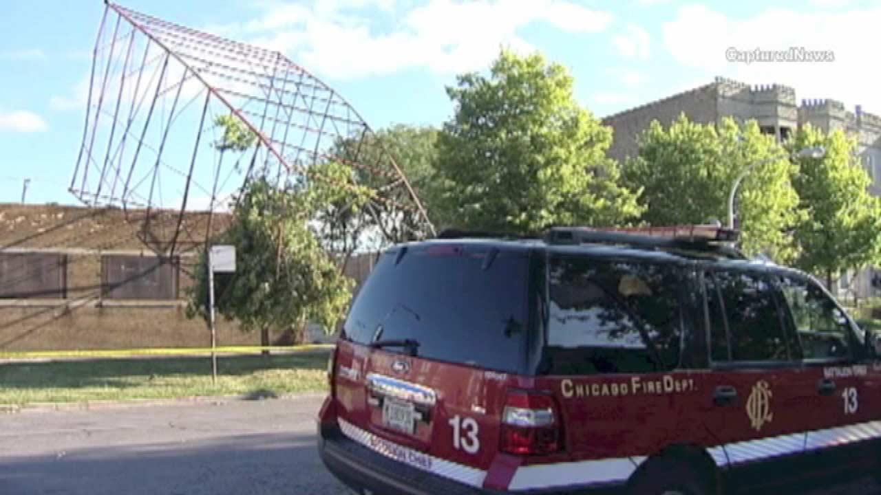 The Chicago Fire Department is trying to figure out what caused a large communications tower to topple onto a sidewalk.