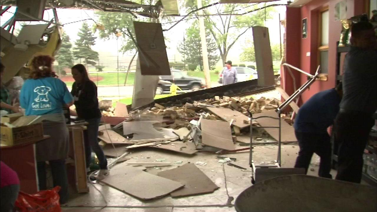 Workers sift through the rubble after school bus crashed into the front of an animal rescue center in the 7100-block of West Touhy in north suburban Niles Wednesday afternoon.