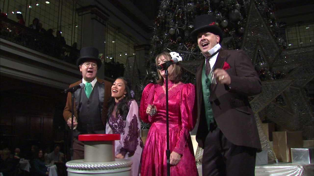 In the Walnut Room at Macys on State Street, carolers celebrate the lighting of the great tree.