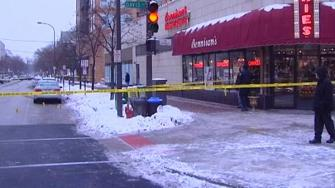 Police shot and killed a man suspected of robbing the Chase Bank on Grove Street in north suburban Evanston.
