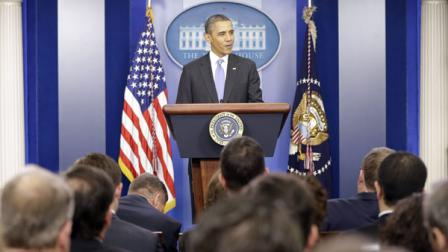 FILE: President Barack Obama speaks during an end-of-the year news conference in the Brady Press Briefing Room at the White House in Washington
