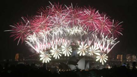 Fireworks explode over the Harbour Bridge and the Opera House during New Years Eve celebrations in Sydney, Australia, Wednesday, Jan. 1, 2014.