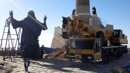 This Oct. 14, 2013 photo provided by the St. Pauls and St. Georges Foundation shows workers preparing to install a statue of Jesus on Mount Sednaya, Syria. In the midst of a civil war rife with sectarianism, a 12.3-meter (40-foot) tall, bronze statue of Jesus has gone up on a Syrian mountain, apparently under cover of a truce among three factions - Syrian forces, rebels and gunmen in the Christian town of Sednaya. (AP Photo/Samir El-Gadban, St. Pauls and St. Georges Foundation)